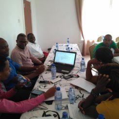 Participants at an HNAP development meeting